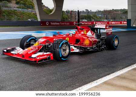JEREZ DE LA FRONTERA, SPAIN - JAN 31: Fernando Alonso of Scuderia Ferrari F1 leaving the pit on training session on January 31 , 2014, in Jerez de la Frontera , Spain - stock photo