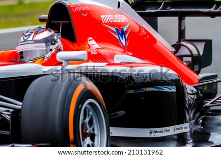 JEREZ DE LA FRONTERA, SPAIN - JAN 31: Jules Bianchi of Marussia F1 races on training session on January 31 , 2014, in Jerez de la Frontera , Spain - stock photo