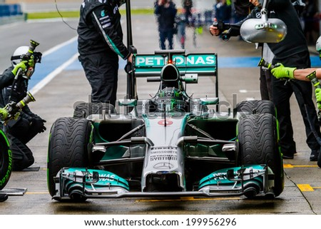 JEREZ DE LA FRONTERA, SPAIN - JAN 31: Nico Rosberg of Mercedes AMG Petronas F1 leaving the pit on training session on January 31 , 2014, in Jerez de la Frontera , Spain - stock photo