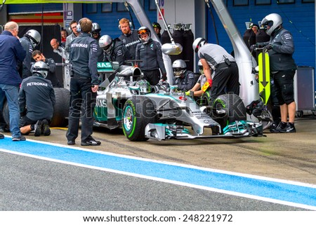 JEREZ DE LA FRONTERA, SPAIN - JAN 31: Nico Rosberg of Mercedes AMG Petronas F1 leaving the pit on training session on January 31 , 2014, in Jerez de la Frontera, Spain - stock photo