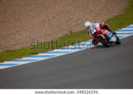 JEREZ DE LA FRONTERA, SPAIN - NOV 20: 125cc motorcyclist Miguel Oliveira takes a curve in the CEV Championship on Nov 20, 2010, in Jerez de la Frontera, Spain - stock photo