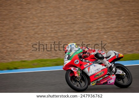 JEREZ DE LA FRONTERA, SPAIN - NOV 20: 125cc motorcyclist Toshimitsu Gondo races in the CEV championship on Nov 20, 2010, in Jerez de la Frontera, Spain - stock photo