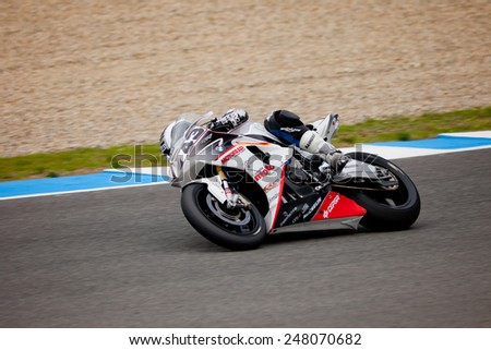 JEREZ DE LA FRONTERA, SPAIN - NOV 20: Stock Extreme motorcyclist Enrique Rocamora takes a curve in the CEV championship on Nov 20, 2010, in Jerez de la Frontera, Spain - stock photo