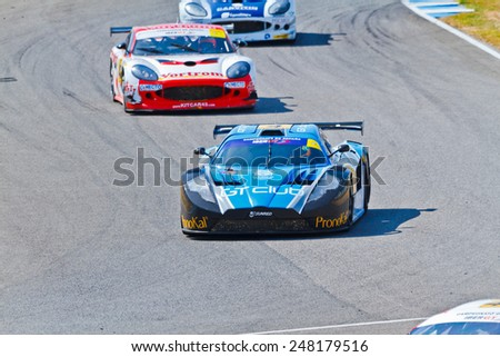 JEREZ DE LA FRONTERA, SPAIN - OCT 16: Ferran Monje(4) followed by Francesc Gutierrez(42) and Pedro Lopes(44) races on Iber GT championship on October 16 , 2011, in Jerez de la Frontera , Spain - stock photo