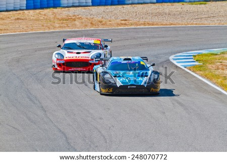 JEREZ DE LA FRONTERA, SPAIN - OCT 16: Ferran Monje(4) followed by Francesc Gutierrez(42)races on Iber GT championship on October 16 , 2011, in Jerez de la Frontera, Spain - stock photo