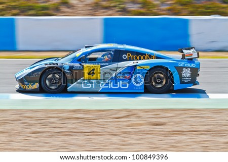 JEREZ DE LA FRONTERA, SPAIN - OCT 16: Ferran Monje of SUNRED races on Iber GT championship on October 16 , 2011, in Jerez de la Frontera , Spain - stock photo
