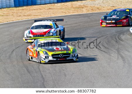 JEREZ DE LA FRONTERA, SPAIN - OCT 16: Jose Pedro Fontes 25 followed by Joao Figueiredo 21 and Joao Ramos 10 races on Iber GT championship on October 16 , 2011, in Jerez de la Frontera , Spain - stock photo