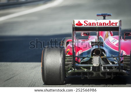 JEREZ, SPAIN - FEBRUARY 3RD: Kimi Raikkonen testing his new Ferrari SF15-T F1 car on the first Test at the Jerez Circuit in Jerez, Andalucia, Spain on Feb. 3, 2014. - stock photo
