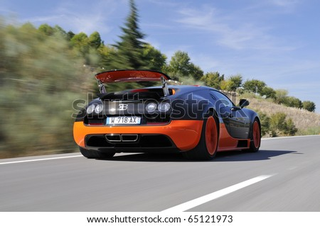 JEREZ, SPAIN - SEPTEMBER 19: The Bugatti Veyron Super Sport, the World's Fastest Production Car, on show and driven on September 19, 2010, on the mountain roads around Jerez, Spain, organized by Bugatti. - stock photo