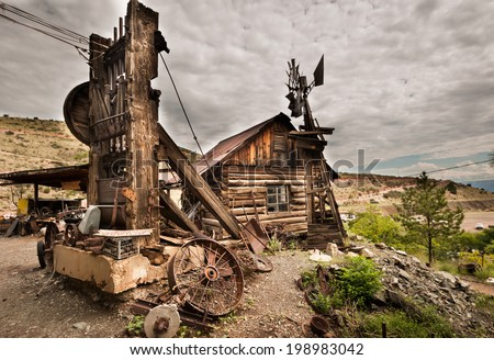 Jerome Arizona Ghost Town mine windmill and old block house - stock photo