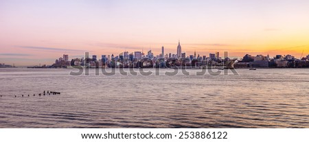 Jersey city - NJ circa dec 2014: Manhattan skyline view from harborside hudson river in jersey city at dawn time. - stock photo