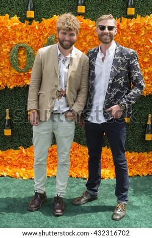 Jersey City, NJ USA - June 4, 2016: Timo Weiland (L) attends 9th annual Veuve Clicquot Polo Classic at Liberty State Park - stock photo