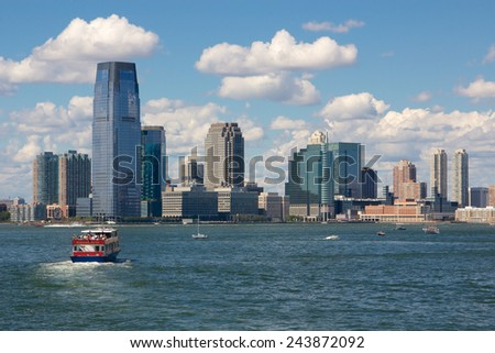JERSEY CITY, NJ, USA - SEPTEMBER 9, 2012: View of the towers of downtown Jersey City from the waters of New York Harbor in Jersey City, NJ, USA on September 9, 2012. - stock photo