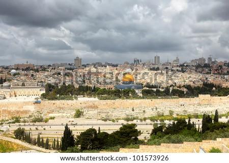 Jerusalem and stormy clouds - stock photo