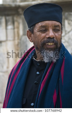 JERUSALEM - APRIL 14 : Ethiopian Orthodox priest await the start of the Holy fire ceremony at the Ethiopian section of the Holy Sepulcher in Jerusalm Israel on April 14 2012