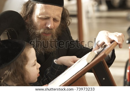 JERUSALEM - APRIL 4: Unidentified father teaching his unidentified son from the Hebrew holy books on April 4, 2008 in Jerusalem. 