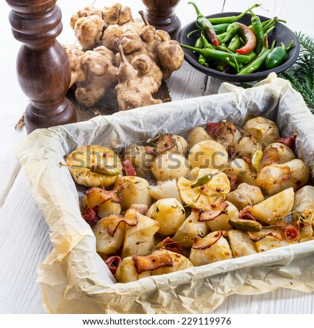Jerusalem artichoke au gratin with ham and chili - stock photo