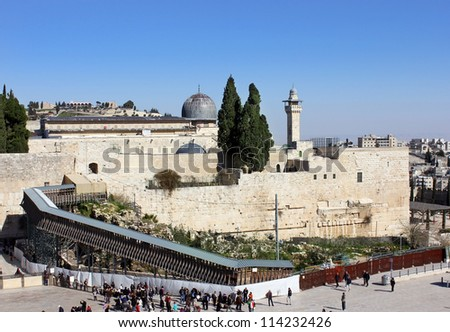 JERUSALEM - AUG. 11:wailing wall and bridge leading to Temple Mount , Jerusalem - August 11, 2012, Israel, bridge over which Israeli police goes over  in  Arab part of Temple Mount during the riots - stock photo