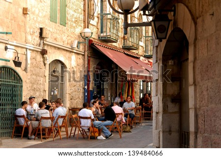 JERUSALEM - AUG 17:Young Israeli people in a cafe in Nahalat Shiva on Oct 17 2007.Jerusalem has been the holiest city in Jewish tradition since King David of Israel first established in 1000 BCE. - stock photo