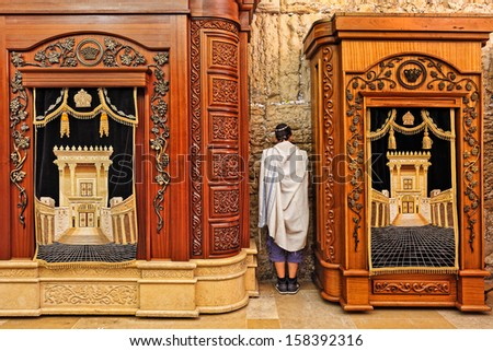 JERUSALEM - AUGUST 21: Two wooden cabinets with Torah scrolls and prayer in Cave Synagogue which is a part of Western Wall - Judaism's holy place in Jerusalem, Israel on August 21, 2013. - stock photo