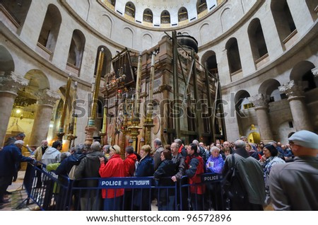 JERUSALEM - FEBRUARY 23: Crowds await entrance to the Edicule February 23, 2012 in Jerusalem, Israel. The Edicule which contains the Sepulchre is said to be where Jesus was buried.