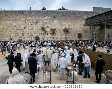 JERUSALEM - ISRAEL - APRIL 29, 2014 : Jewish worshipers pray at Wailing Wall in Jerusalem, Israel on April 20, 2014. - stock photo