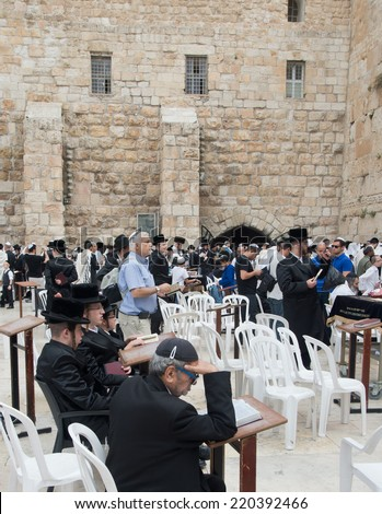 JERUSALEM, ISRAEL - APRIL 20, 2014 : Orthodox religious jews pray at Wailing Wall in Jerusalem, Israel on April 20, 2014. - stock photo