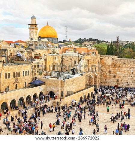 JERUSALEM,ISRAEL - APRIL 04,2015: View on the Temple Mount,Dome of the Rock mosque and Wailing Wall.Orthodox religious Jews and tourists on the Jewish Pesach (Passover) celebration in Jerusalem,Israel