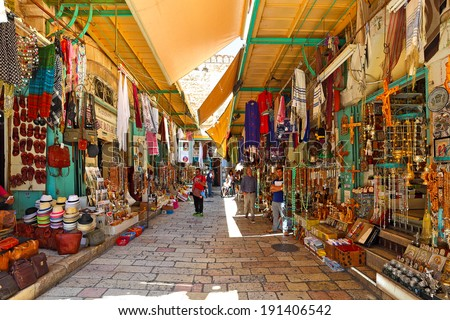 JERUSALEM, ISRAEL - AUGUST 21, 2013: Bazaar in Old City of Jerusalem with variety of middle east traditional products and souvenirs. It is very popular with tourists and pilgrims visiting Holy Land. - stock photo