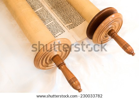 JERUSALEM, ISRAEL, CIRCA 2014:. The Hebrew handwritten Torah, on a synagogue alter, illustrating Jewish holidays, during fests. Half open - stock photo