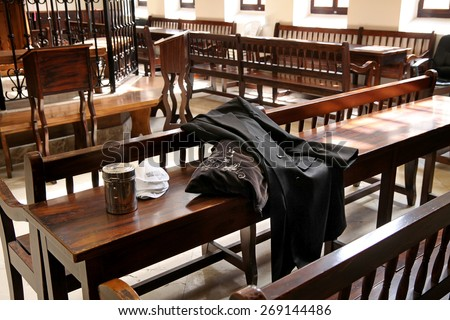 JERUSALEM, ISRAEL - FEBRUARY 21, 2014: Lapserdak, bag and box for donations on the table in the synagogue Ohel Yitzchak in Jerusalem - stock photo