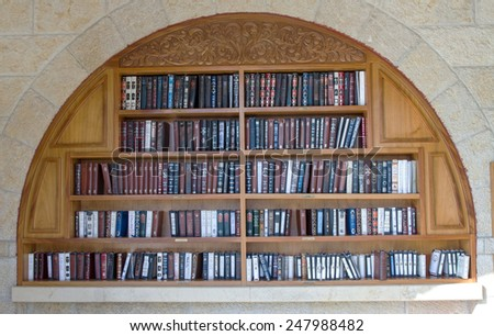 Jerusalem , Israel - January 22, 2015 : Shelves with religious literature in the synagogue next to the Wailing Wall in Jerusalem.  - stock photo