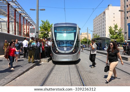 JERUSALEM, ISRAEL - JULY,19, 2015 : Jerusalem Light Rail tram (train) stop with locals and tourists and Central bus station on Jaffa street. Jerusalem is the most visited city by tourists in Israel - stock photo