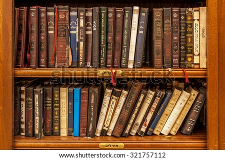JERUSALEM, ISRAEL - JULY 16, 2015: Jewish holy books inside Cave Synagogue (part of Western Wall) prepared for mass prayer during holidays Rosh Hashanah, Yom Kippur and Sukkot. - stock photo