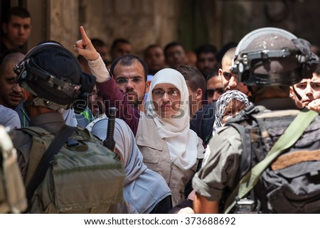 JERUSALEM, ISRAEL - JULY 26, 2015: Palestinian protest against ascent of jews to Temple Mount during Tisha B'Av - annual fast day in Judaism commemorates destruction of First and Second Temples. - stock photo