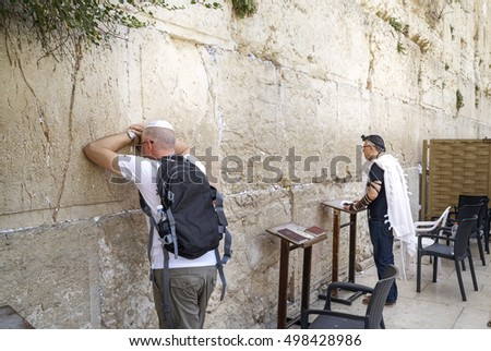 JERUSALEM, ISRAEL - JUNE 3: Jewish worshipers pray at the Wailing Wall. The most holy site for Jews. June 3, 2016 in Jerusalem, Israel.