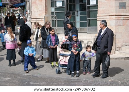 JERUSALEM, ISRAEL - MARCH 15, 2006: Purim carnival. Children and adults dressed in traditional Jewish clothing. Little boy dressed in fancy dress. In the famous quarter of Jerusalem - Mea Shearim.