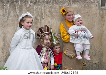 JERUSALEM, ISRAEL - MARCH 15, 2006: Purim carnival in the famous ultra-orthodox quarter of Jerusalem - Mea Shearim. Group portrait of five children dressed in carnival costumes.
