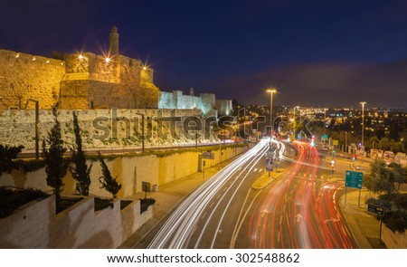 JERUSALEM, ISRAEL - MARCH 4, 2015: The tower of David and west part of old town walls at dusk - stock photo