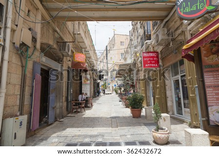 JERUSALEM , ISRAEL - MAY 17 , 2014 : The Streets of the Old city of Jerusalem
