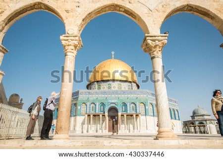 Jerusalem, Israel - November 2, 2015: A muslim ad tourist next to Dome of the Rock mosque  - stock photo