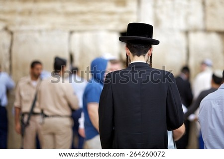 JERUSALEM, ISRAEL - November 18: Jewish worshipers pray at the Wailing Wall November 18, 2013 in Jerusalem, Israel. - stock photo