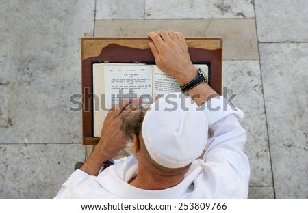JERUSALEM, ISRAEL - OCT 08, 2014: An jewish man is reading in the torah near the wailing wall in Jerusalem