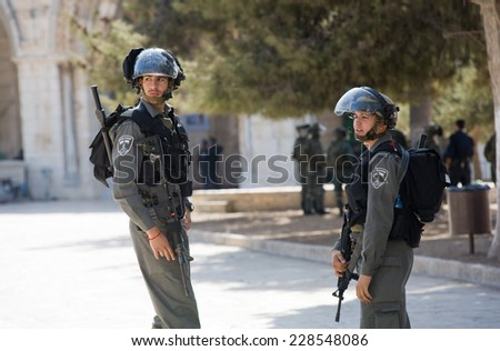 JERUSALEM, ISRAEL - OCT 08, 2014: Israeli police officers in front of the Al-aqsa mosque on the temple-square in Jerusalem keeping the security after fightings with muslims, October 08, 2014 in Israel - stock photo