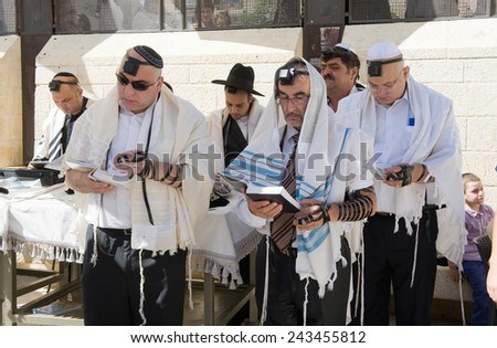 JERUSALEM, ISRAEL - OCT 06, 2014: Jews are reading in the torah during a Bar Mitzvah ritual at the Wailing wall in Jerusalem - stock photo