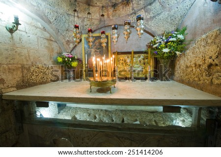 JERUSALEM, ISRAEL - 09 OCT, 2014: The sarcophagus of the The Tomb of the Virgin Mary, the mother of Jesus can be seen through glass - stock photo