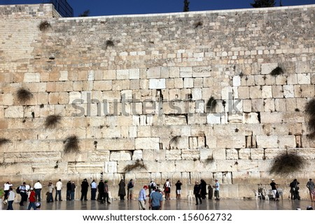 JERUSALEM, ISRAEL - OCTOBER 28: People at the Wailing Wall where Jewish worshipers pray. The most holy site for Jews. October 28, 2010 in Jerusalem, Israel.