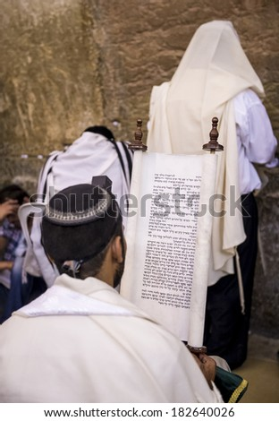JERUSALEM - JULY 29 : Jewish men prays in the Wailing wall during the Jewish holyday of Tisha B'av , on July 29 2012 in old Jerusalem , Israel  - stock photo