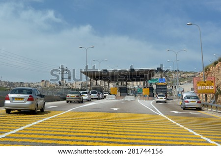 JERUSALEM - MAR 19 2015:Israel Border Police checkpoint to Jerusalem from Maale adumim. The barrier erected by the IDF with the stated aim of enhancing the security of Israel and Israeli settlements. - stock photo