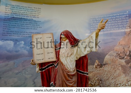 JERUSALEM - MAR 25 2015:Prophet Moses in Bible city in Jerusalem, Israel.Bible City exhibit a series of large life-size dioramas that depict 62 of the most monumental scenes from the Old Testament - stock photo
